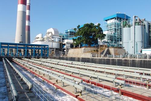 2006年10月28日总承包建设的国产首台300兆瓦机组海水烟气脱硫装置在厦门嵩屿电厂成功投运.jpg